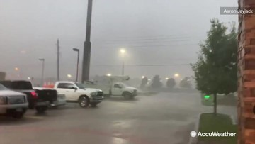 Squall line blasts through parking lot