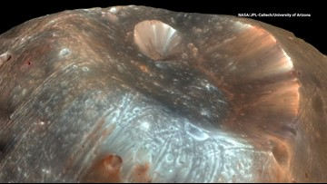 Mars' Moon Gets its Colors from Powder Flowing Across its Surface