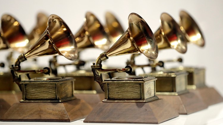 Grammys may cut nomination review committees, AP sources say