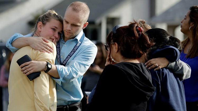 Teacher comforting student after California High School Shooting Nov 14