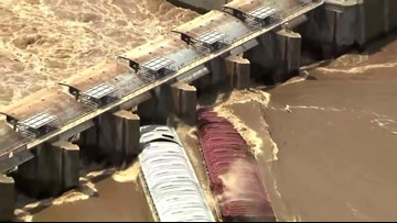 Watch: Runaway barges smash into dam on swollen river in Oklahoma