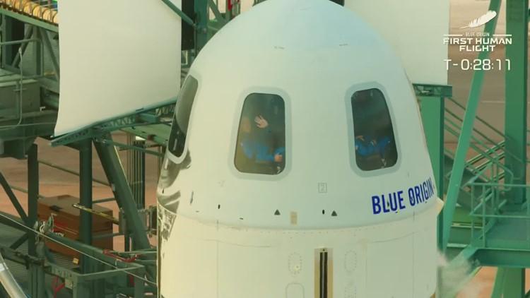 Jeff Bezos, Blue Origin flight crew board New Shepard rocket