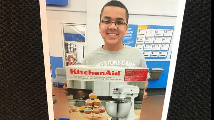 Isaiah Tuckett with his newly-purchased KitchenAid mixer.