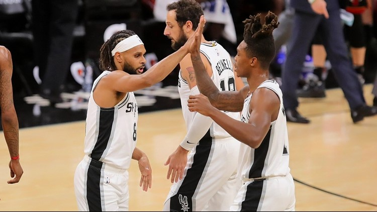 Spurs guard Patty Mills high-fives Lonnie Walker IV during game against Heat 01192020