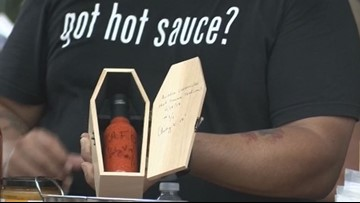 Hot sauce in a coffin is just one of many samples at Hot Sauce Festival