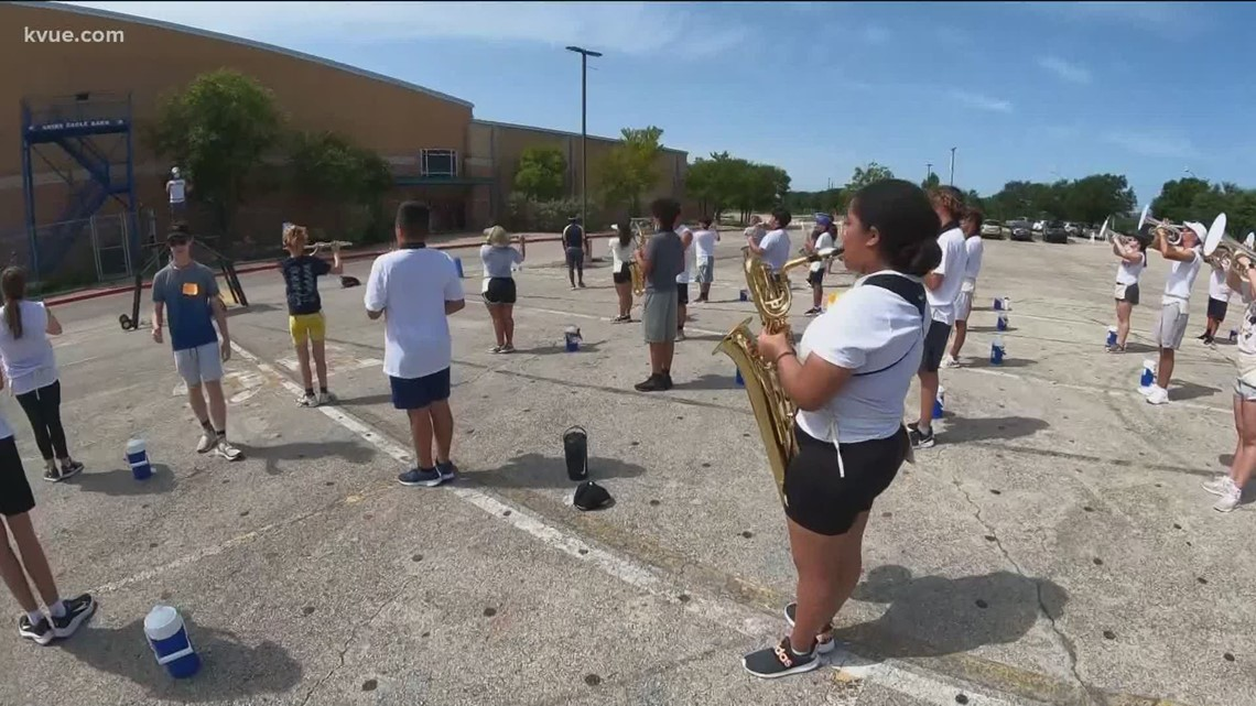 Akins High School marching band braves camp in the heat
