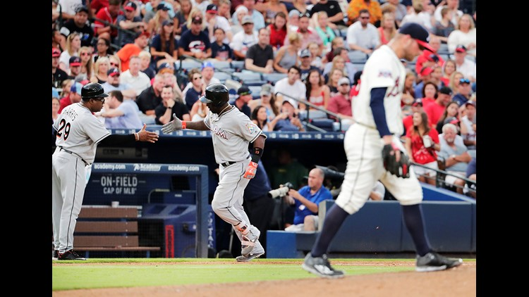 Dietrich Hits Hr Drives In 4 As Marlins Beat Braves 7 3 Kvue Com