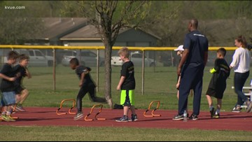 Austin police officers run track and field with kids