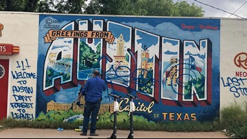 Iconic 'Greetings From Austin' mural cleaned up after being vandalized