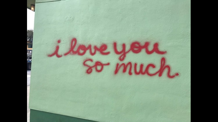 I Love You So Much Wall Restored After Someone Spray Paints Across
