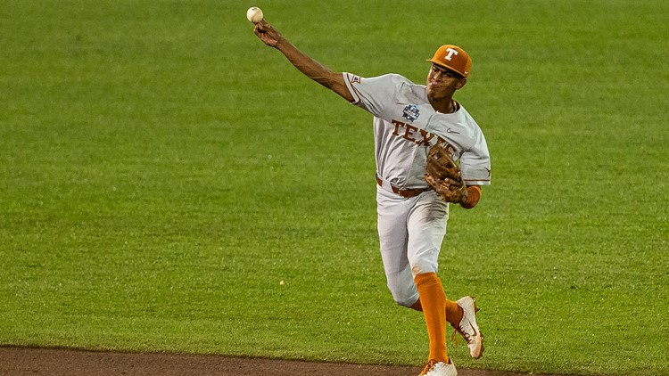 In photos: Texas Longhorns survive CWS elimination with 6-2 win over Virginia Cavaliers