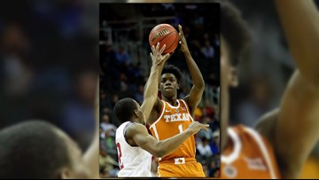 Texas basketball player Andrew Jones is taking leukemia by the horns and winning