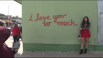 Austinites express their love at one of the city's most iconic murals