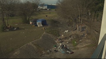 Cleaning up homeless camp next to North Austin apartment complex is property owner's responsibility, City says