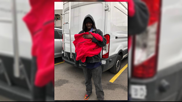 Cielo Property Group passes out red sweaters to homeless people in Austin