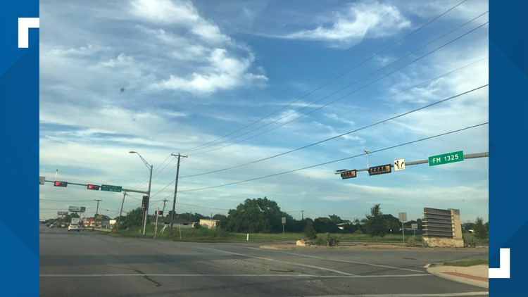 The intersection of FM 1325 and Quick Hill Road.