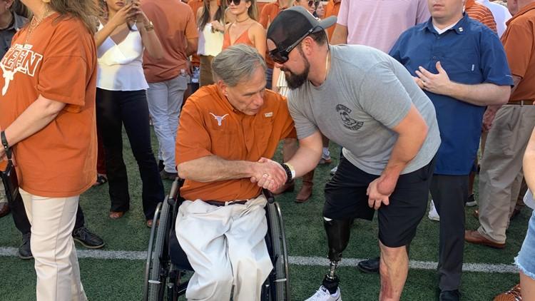 Marine veteran meets Gov. Greg Abbott at coin toss