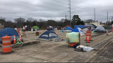 State homeless camp residents plan counter offer to Gov. Abbott's $1 lease