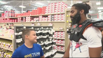 WATCH: Former Longhorn Michael Griffin took 16 Austin kids on a $200 'Back To Sport' shopping spree