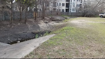 Homeless camp bordering North Austin apartments cleaned up after complaints