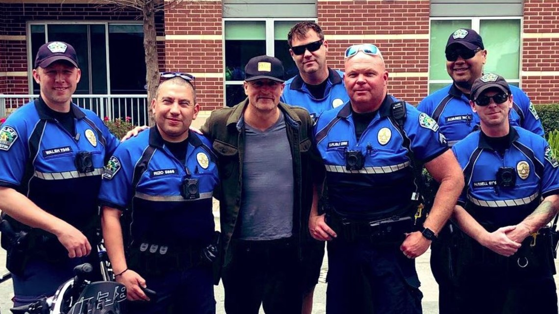 Woody Harrelson takes a moment to snap a photo with Austin police at SXSW