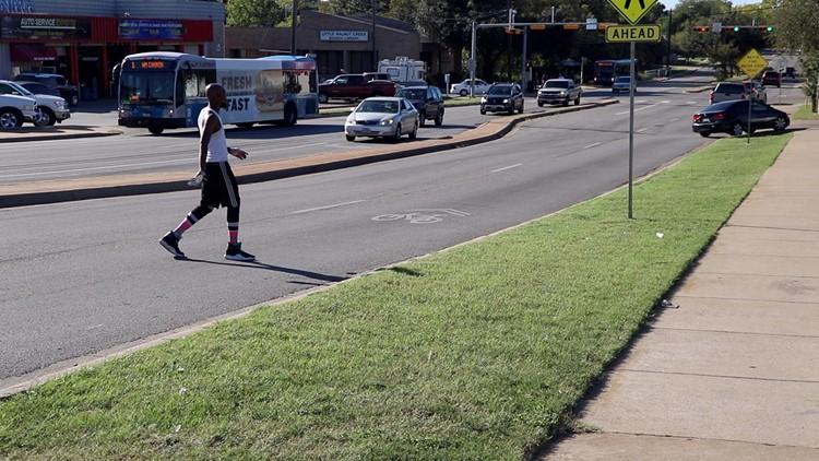 Man walking outside of a crosswalk.