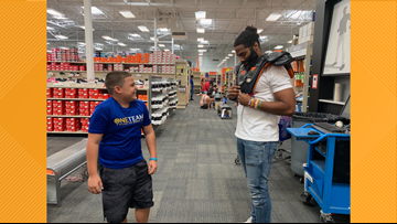 Former Longhorn Michael Griffin took 16 Austin kids on a $200 'Back To Sport' shopping spree