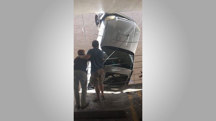 William O'Connor and a good Samaritan in a downtown Austin parking garage after O'Connor's car went over the side on Sept. 9.