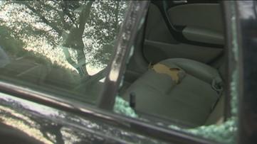 Video shows woman throw hatchet through car window