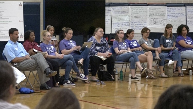 Parents from Pease Elementary attend Tuesday night's meeting.