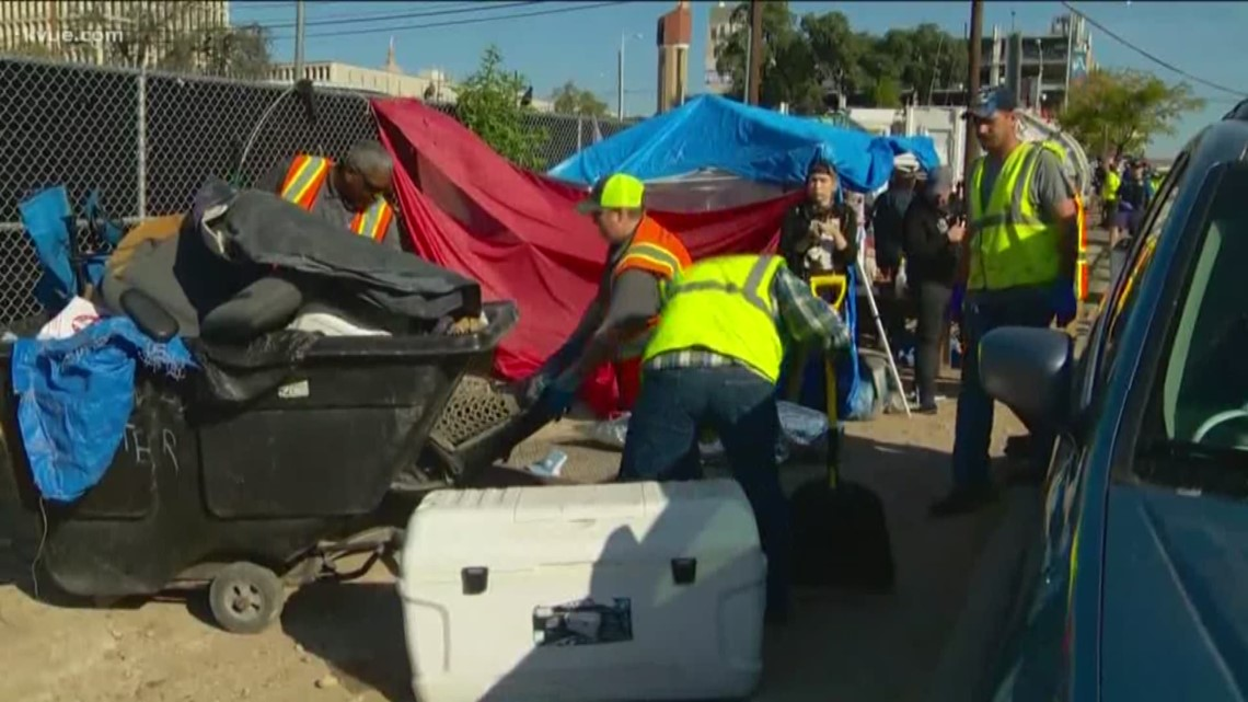 'We're not leaving.' City crews begin cleaning up homeless camps near the ARCH in Downtown Austin