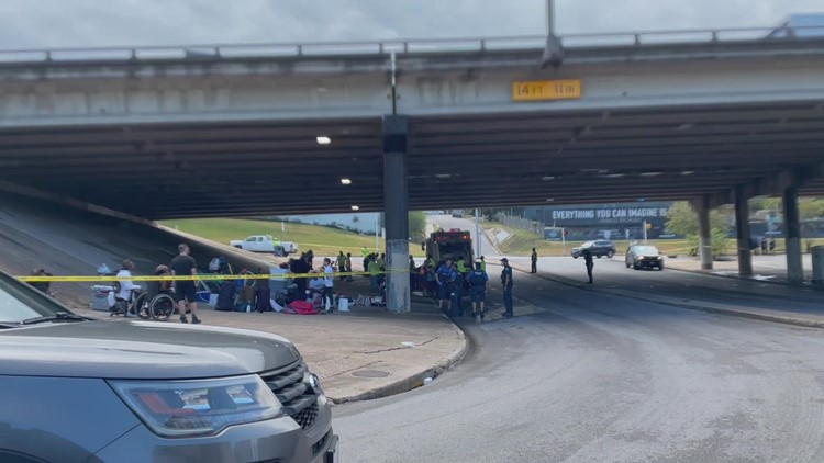 Homeless camp cleanup under I-35 overpass in Downtown Austin