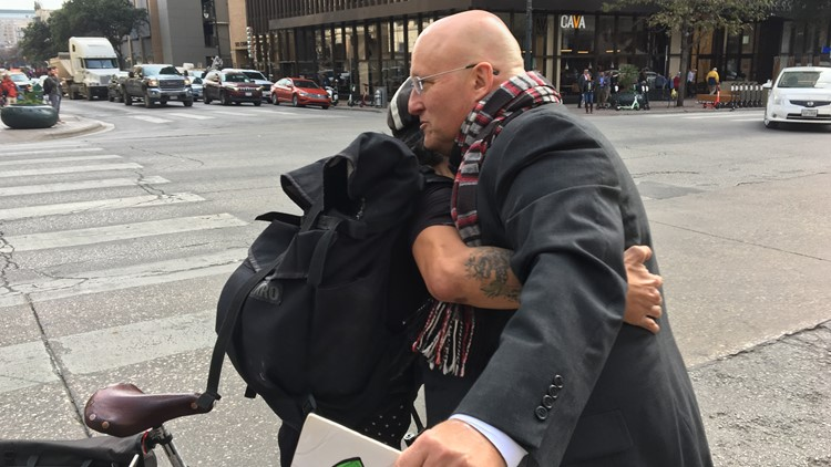 Austinites ditch their phones and share hugs with strangers on 'Austin Free Hug Day'