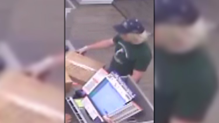 Surveillance photo povided by law enforcement believed to depict Mark Conditt dropping off package at FedEx on Brodie Lane.
