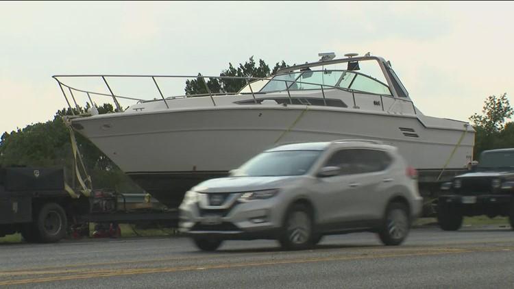 40,000-pound boat stranded on side of SH 71