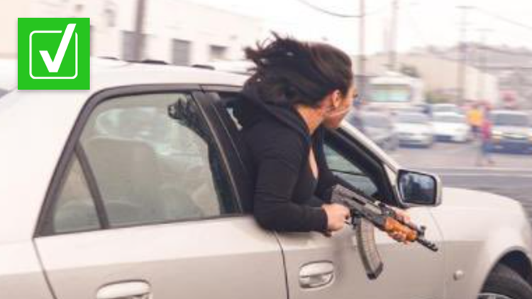 Yes, the photo of a woman holding an AK-47 in San Francisco is real