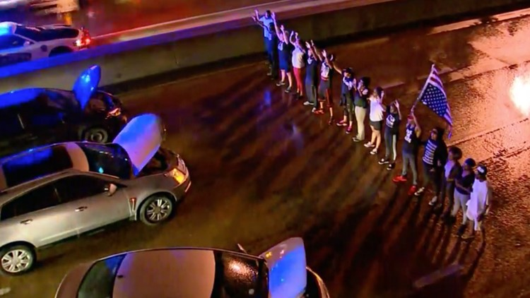 Dozens protest over Botham Jean shooting, briefly shutting down I-30