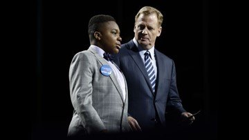 Young cancer survivor gets his wish at NFL draft