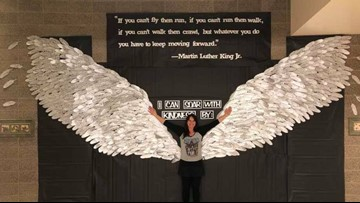 Elementary students make wings out of 700 feathers to honor MLK